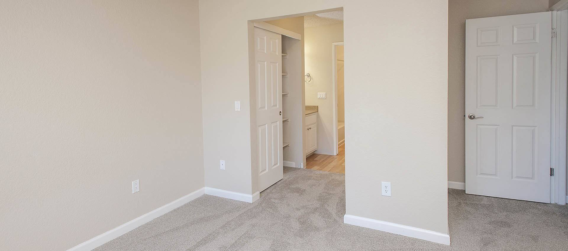 Carpeted Bedroom at Plum Tree Apartment Homes in Martinez, CA
