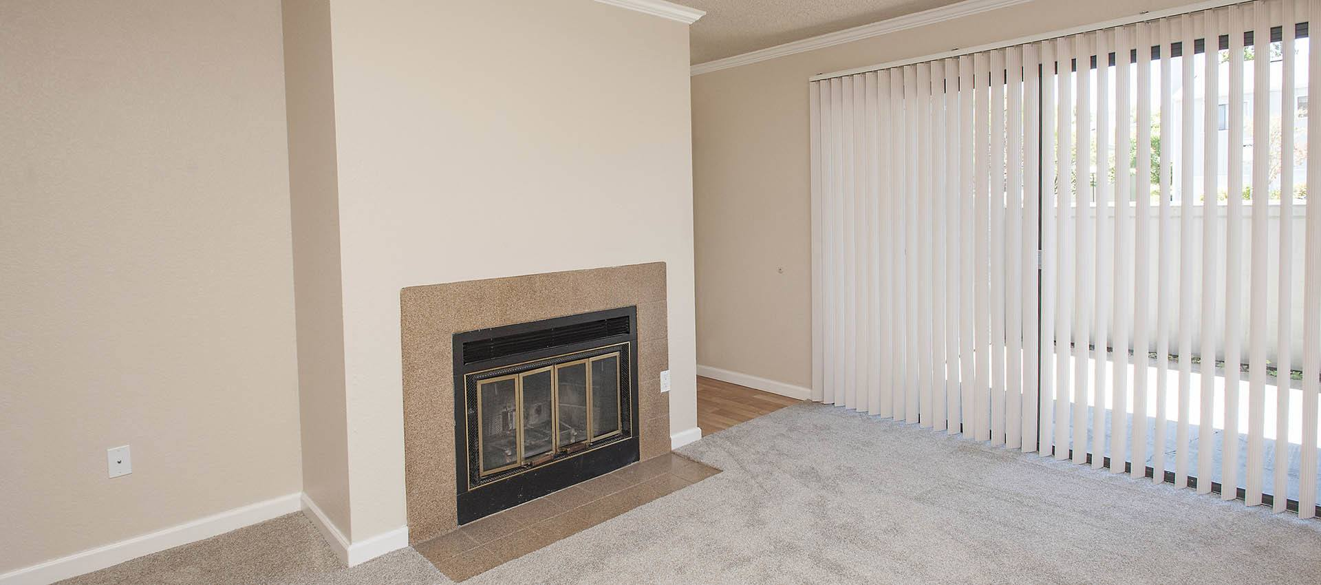 Fireplace In Living Room at Plum Tree Apartment Homes in Martinez, CA