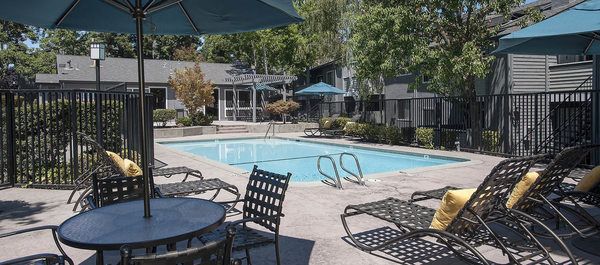 Picnic Table With Umbrella Near Pool at Plum Tree Apartment Homes in Martinez, CA