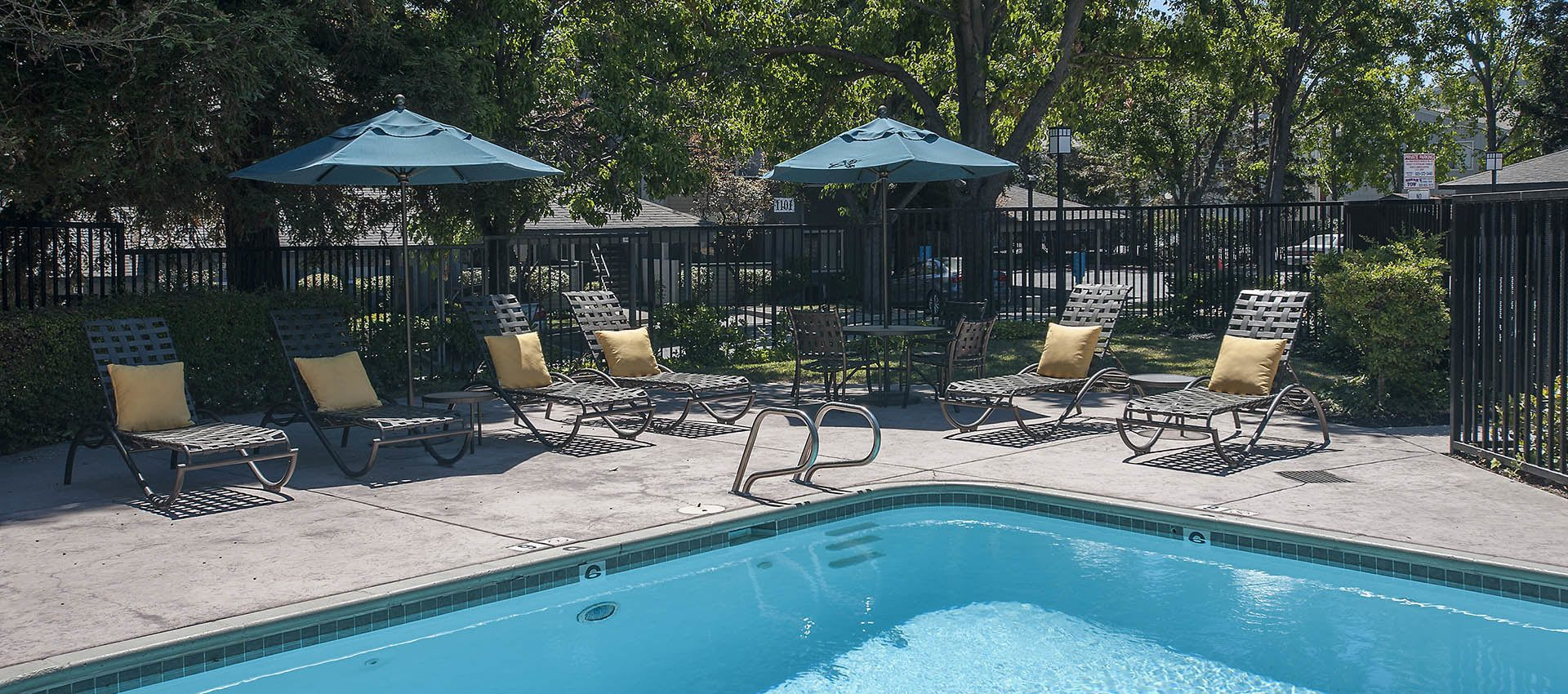 Sun chairs Around Pool at Plum Tree Apartment Homes in Martinez, California