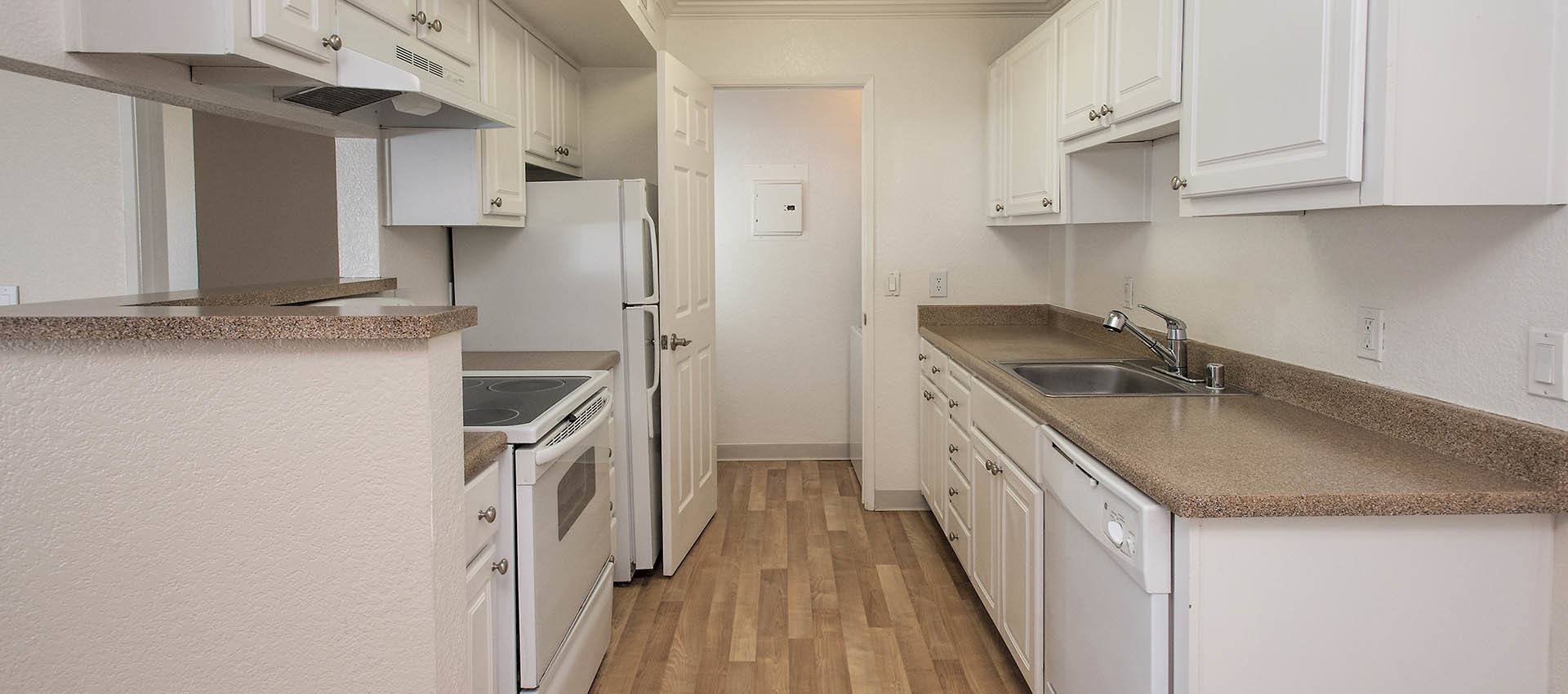 White Cabinets And Appliances at Plum Tree Apartment Homes in Martinez, CA