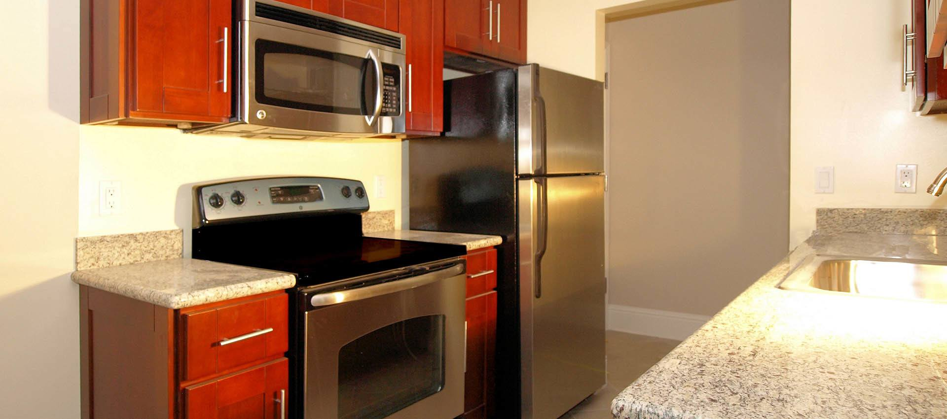 Kitchen with stainless steel appliances at apartments in Martinez, CA