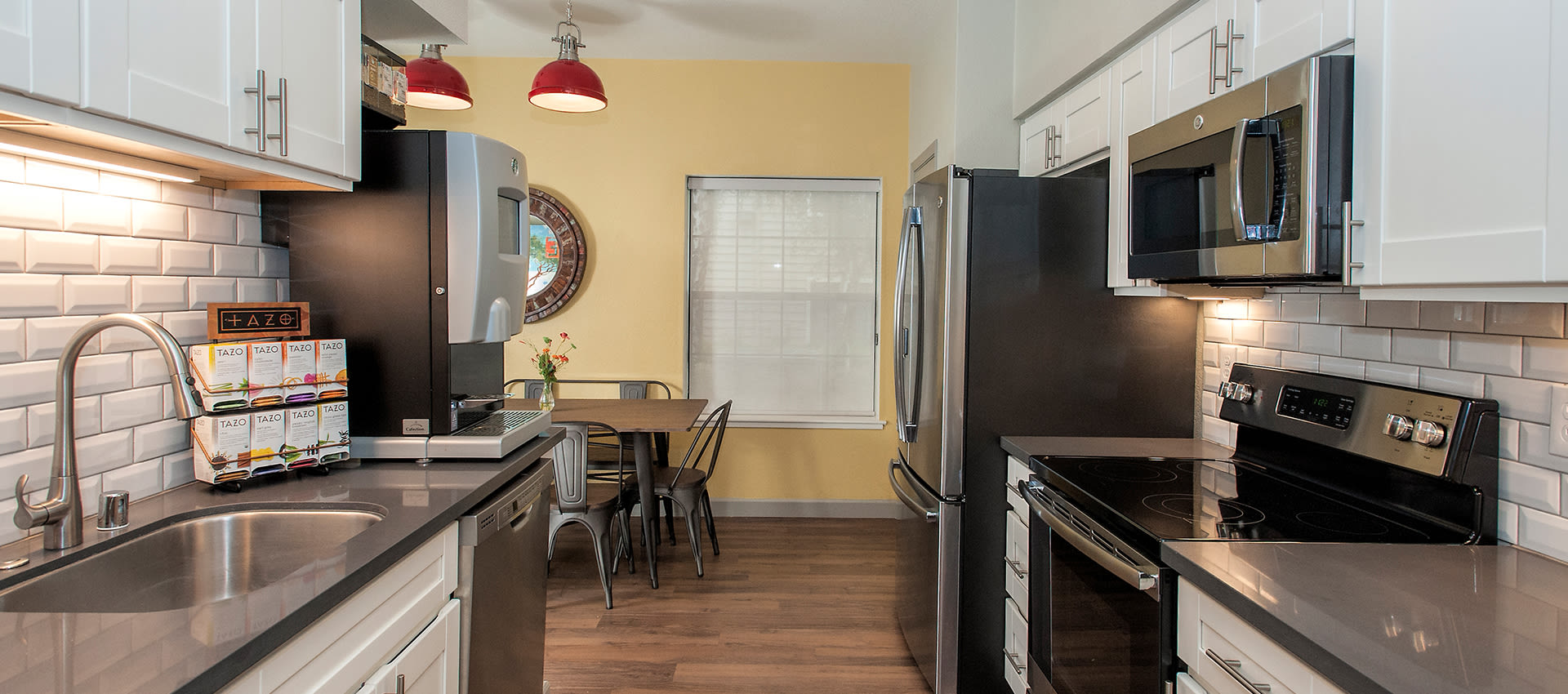 Entertaining kitchen and coffee bar at Reserve at Capital Center Apartment Homes in Rancho Cordova, CA