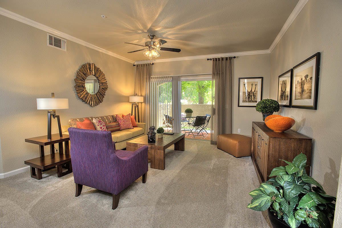 Living Area With Sliding Glass Door at River Oaks Apartment Homes in Vacaville