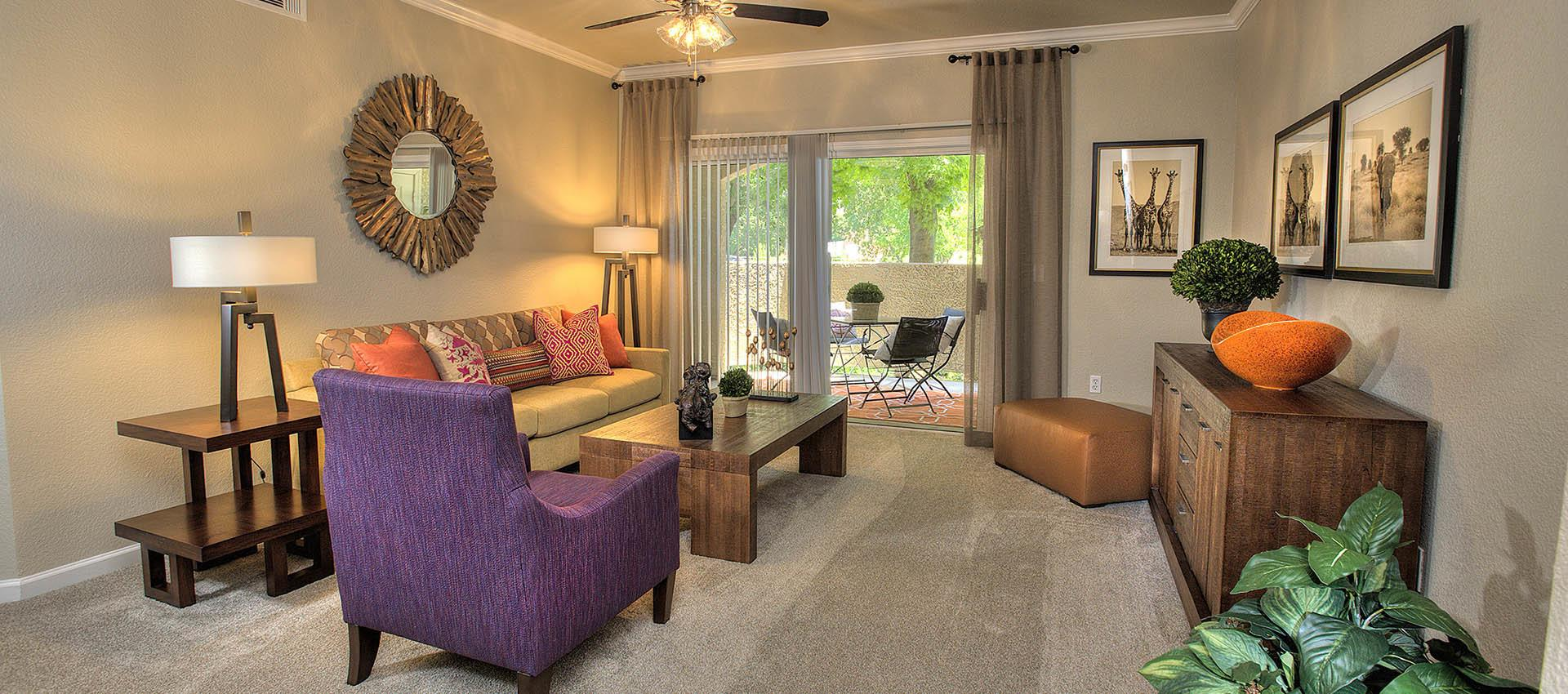 Living Room With Back Deck at River Oaks Apartment Homes in Vacaville