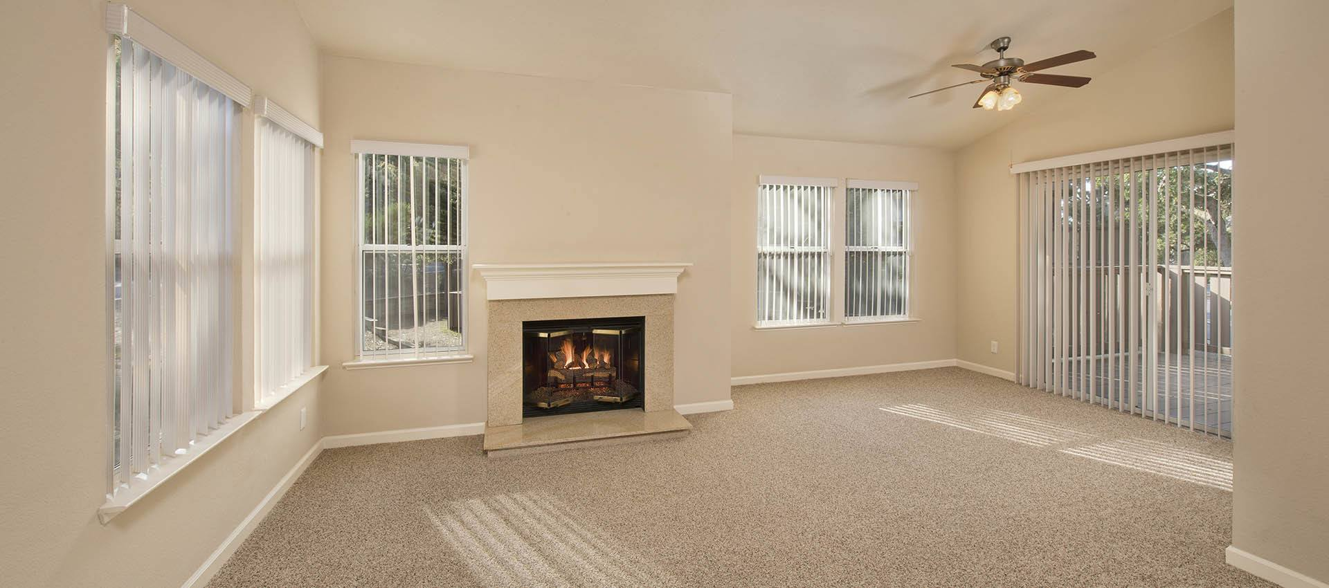 Spacious Living Area With Fireplace at Seventeen Mile Drive Village Apartment Homes in Pacific Grove