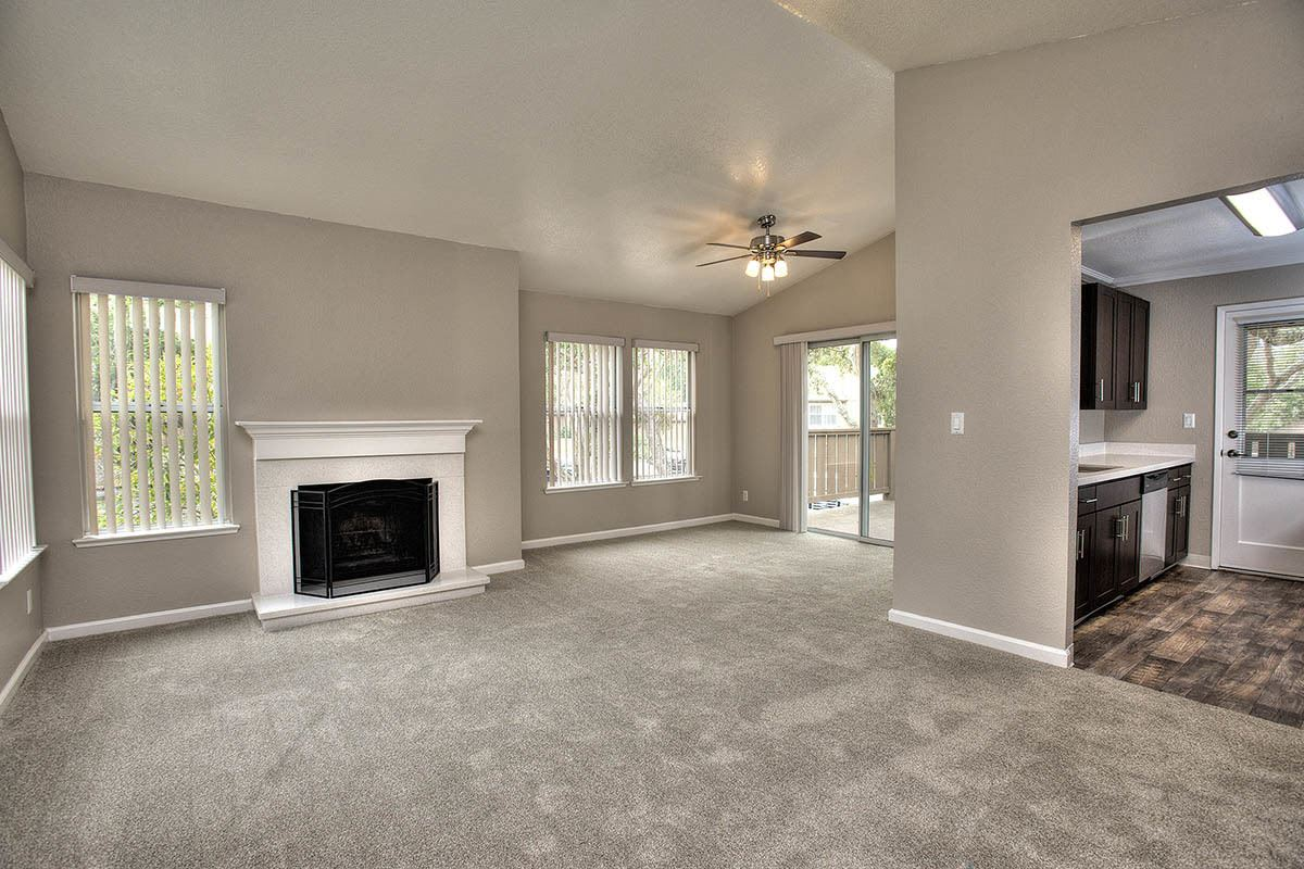 Spacious floor plan with fireplace at Seventeen Mile Drive Village Apartment Homes in Pacific Grove, California