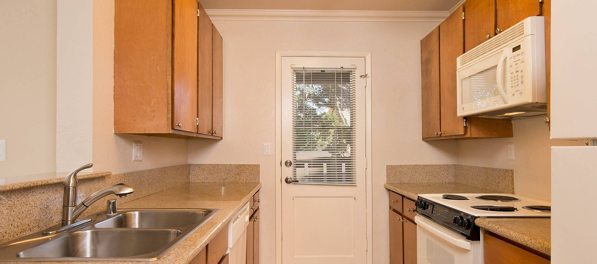 Standard Kitchen at Seventeen Mile Drive Village Apartment Homes in Pacific Grove