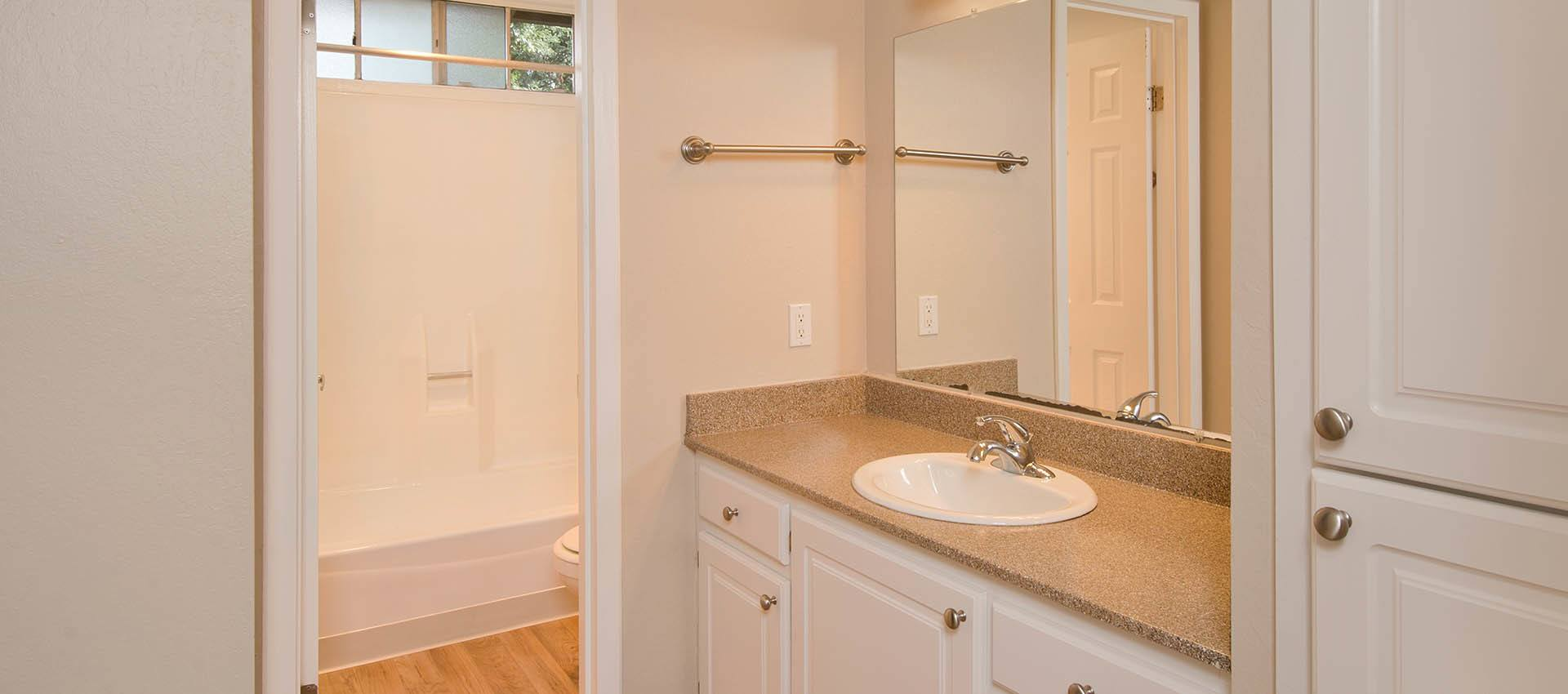 Bathroom With White Cabinets at Shadow Oaks Apartment Homes in Cupertino