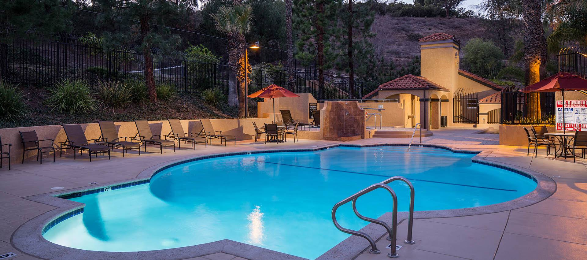 Pool at dusk at Shadow Ridge Apartment Homes in Simi Valley, CA