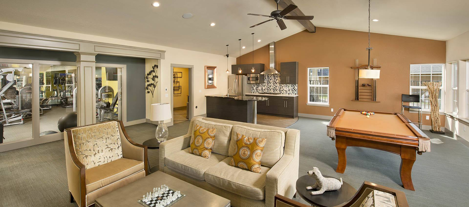 Residents lounge at Slate Ridge at Fisher's Landing Apartment Homes in Vancouver, WA