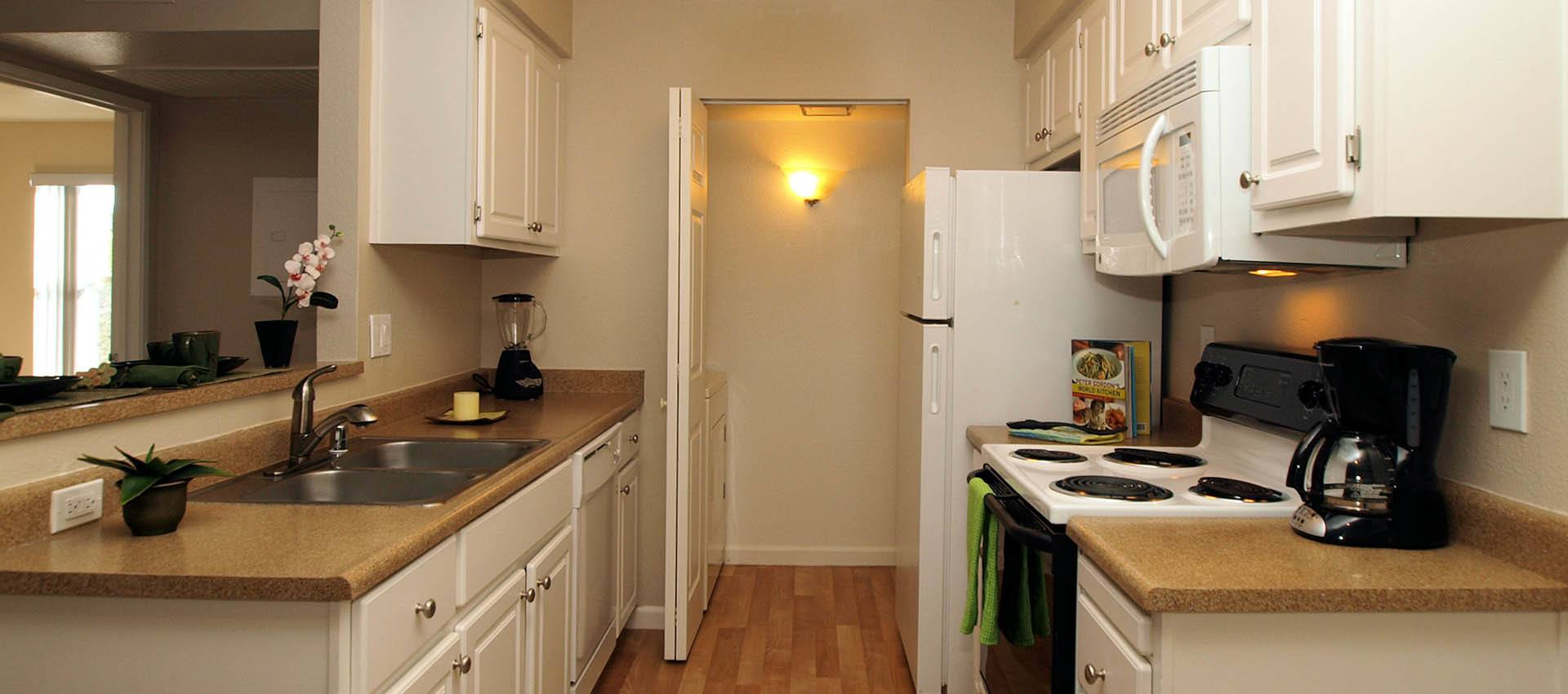 Kitchen With White Cabinets at Sterling Heights Apartment Homes in Benicia