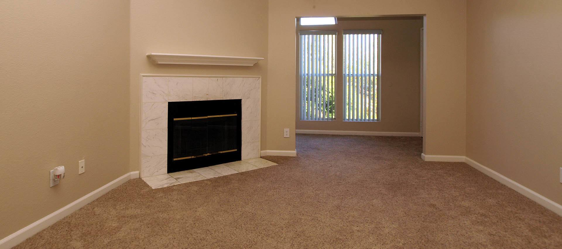 Living Room With Fireplace at Sterling Heights Apartment Homes in Benicia