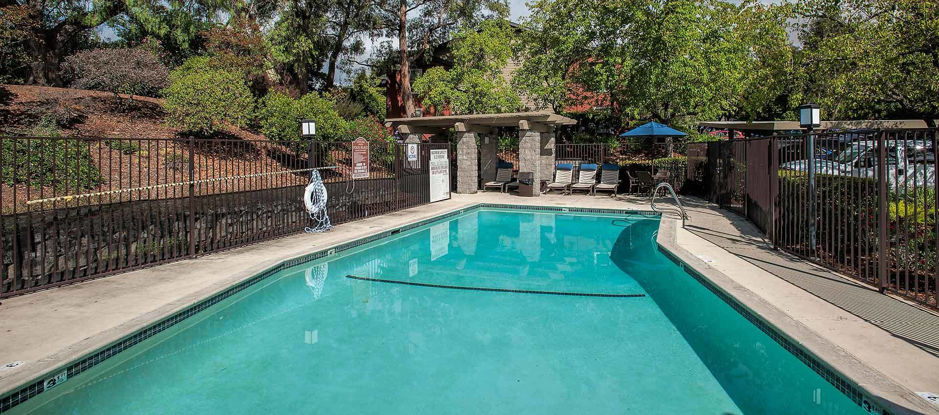 Seating By The Pool at Sterling Heights Apartment Homes in Benicia