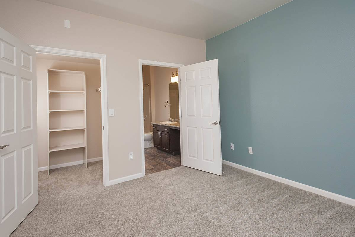 Bedroom and attached bathroom at The Vintage at South Meadows Condominium Rentals in Reno