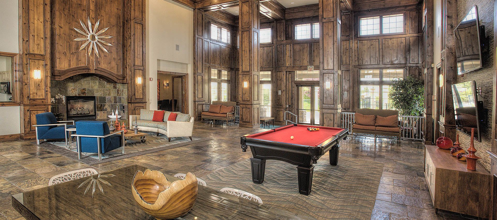 inside of clubhouse with billiards table at The Vintage at South Meadows Condominium Rentals in Reno