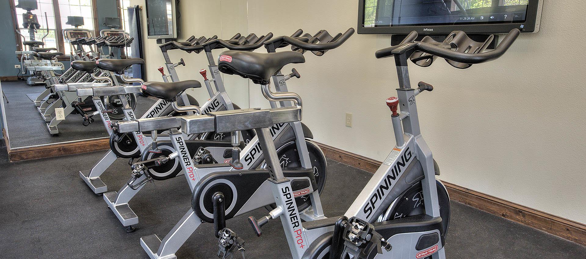 Fitness Center with OnDemand Spin at The Vintage at South Meadows Condominium Rentals in Reno