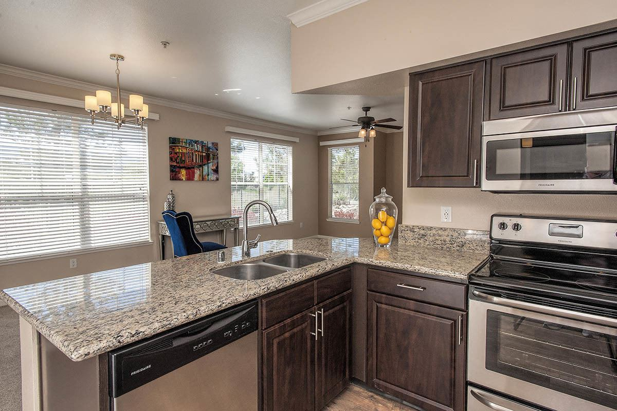 Luxury Kitchen with stainless steel fixtures at The Vintage at South Meadows Condominium Rentals in Reno