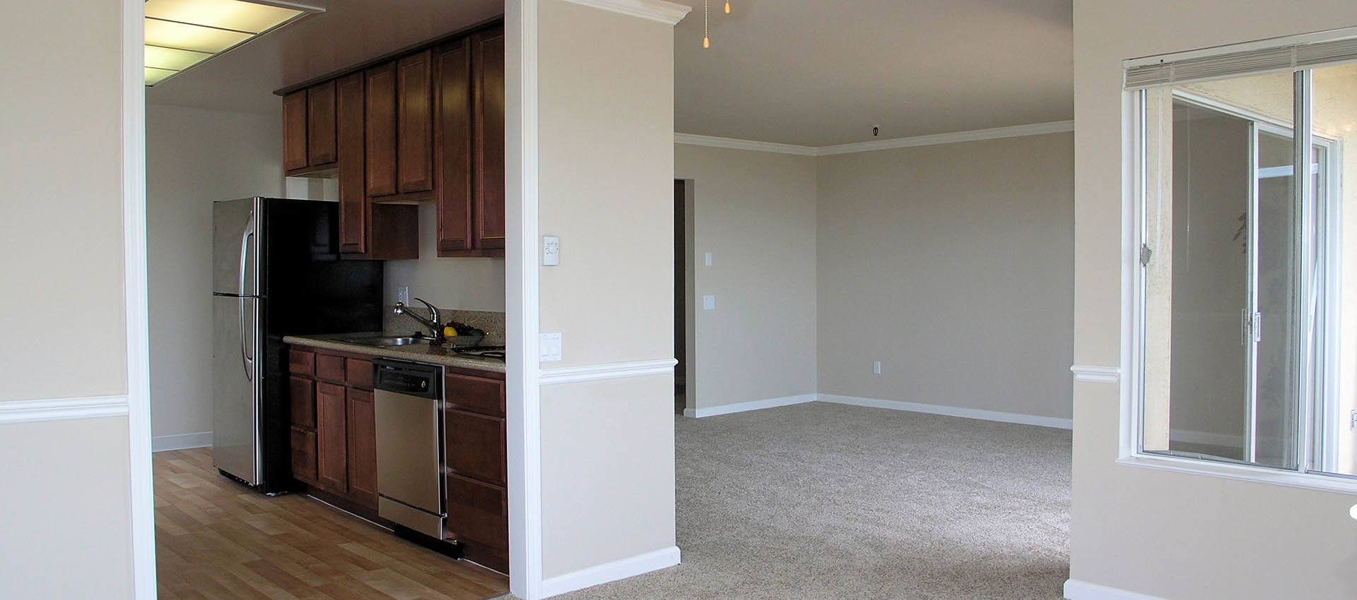 Kitchen and living room at Tower Apartment Homes in Alameda, CA