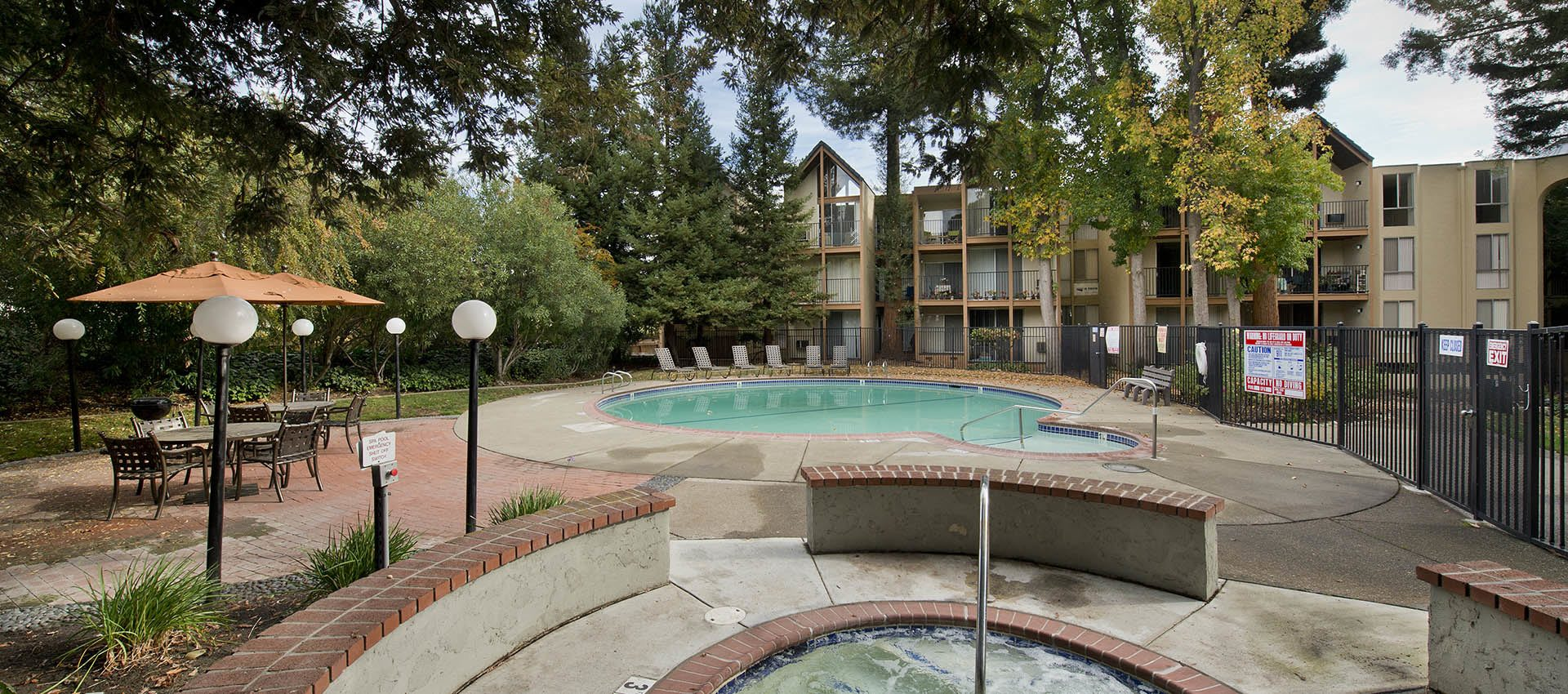 Pool deck with spa at Atrium Downtown in Walnut Creek, California