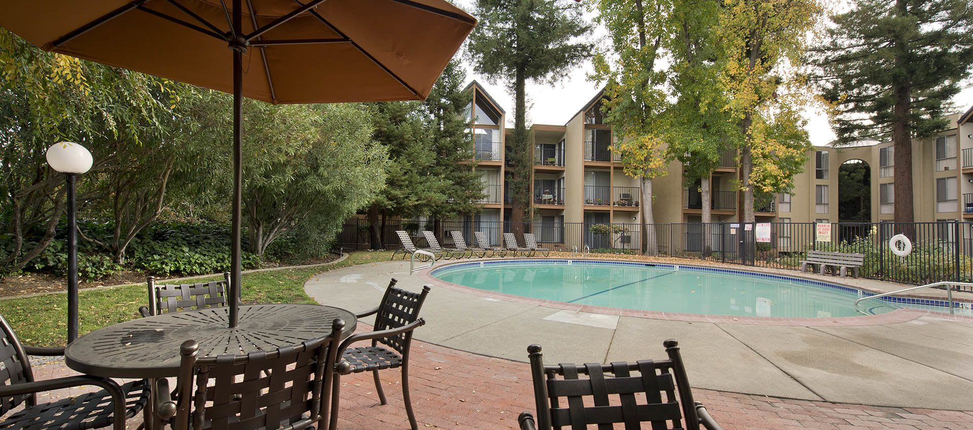 Pool and shaded seating nearby at Atrium Downtown in Walnut Creek, California