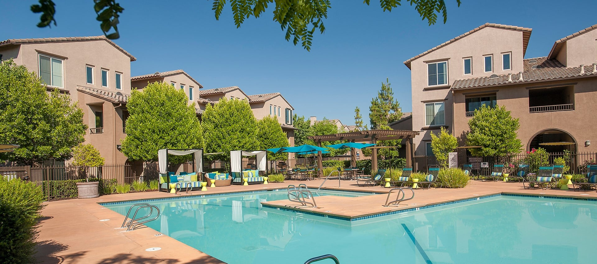 Expansive pool with sun deck at Venu at Galleria Condominium Rentals in Roseville, California