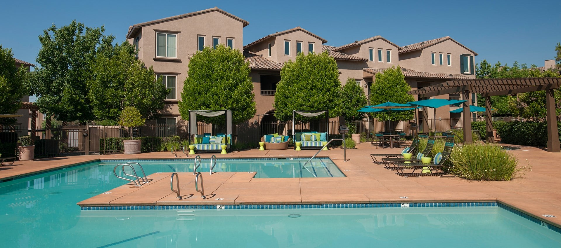 Large swimming pool at Venu at Galleria Condominium Rentals in Roseville, California