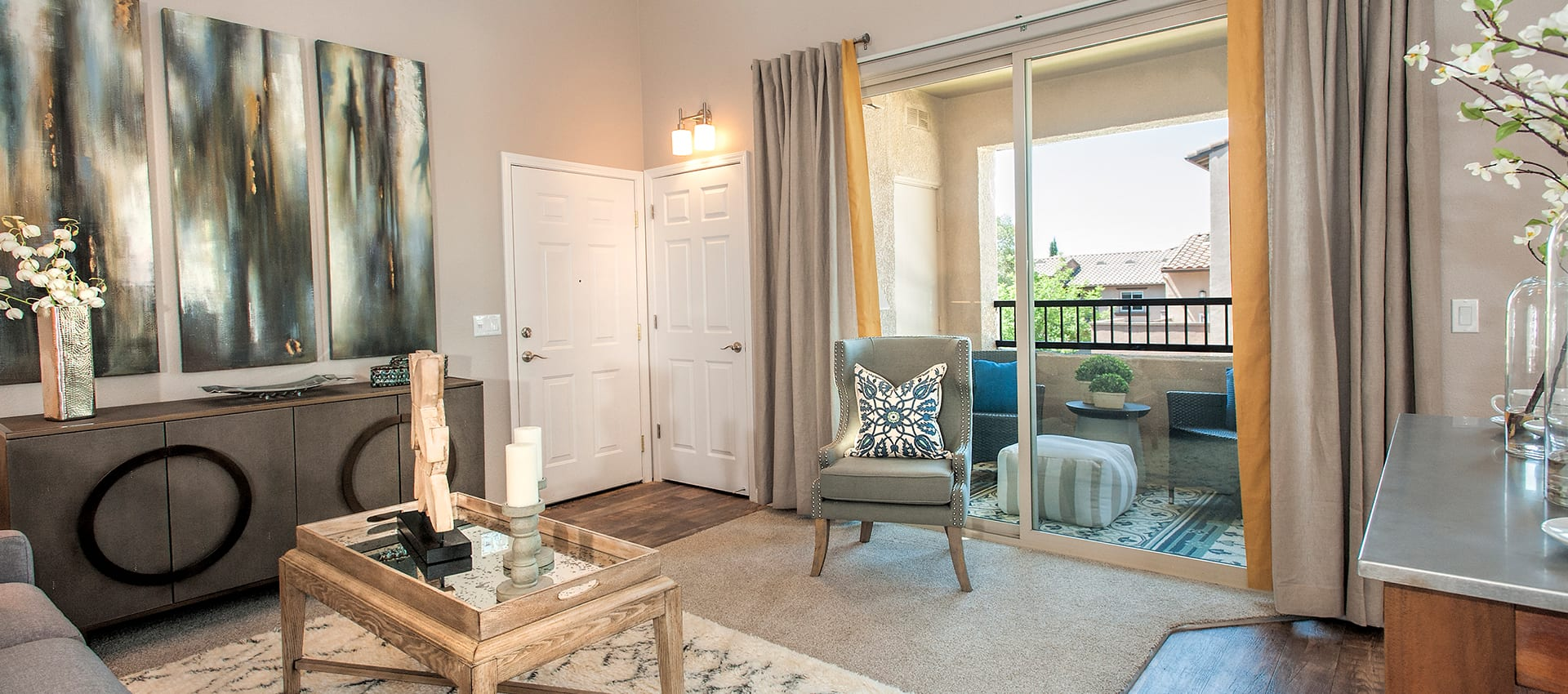 Model room featuring sliding glass door at Venu at Galleria Condominium Rentals in Roseville, California