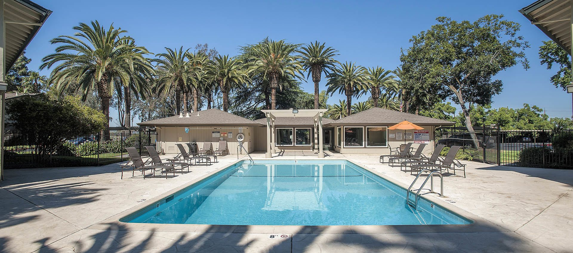 Amenities include a sparkling outdoor pool at Villa Palms Apartment Homes in Livermore, California