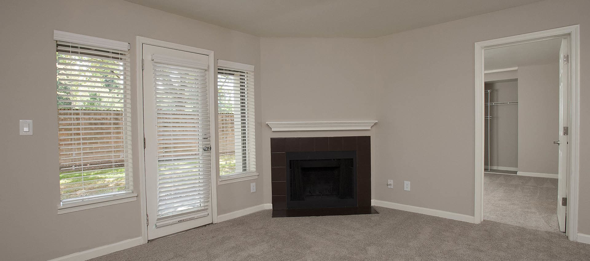 Fireplace In Living Room With Exterior Door at Waterhouse Place in Beaverton, OR