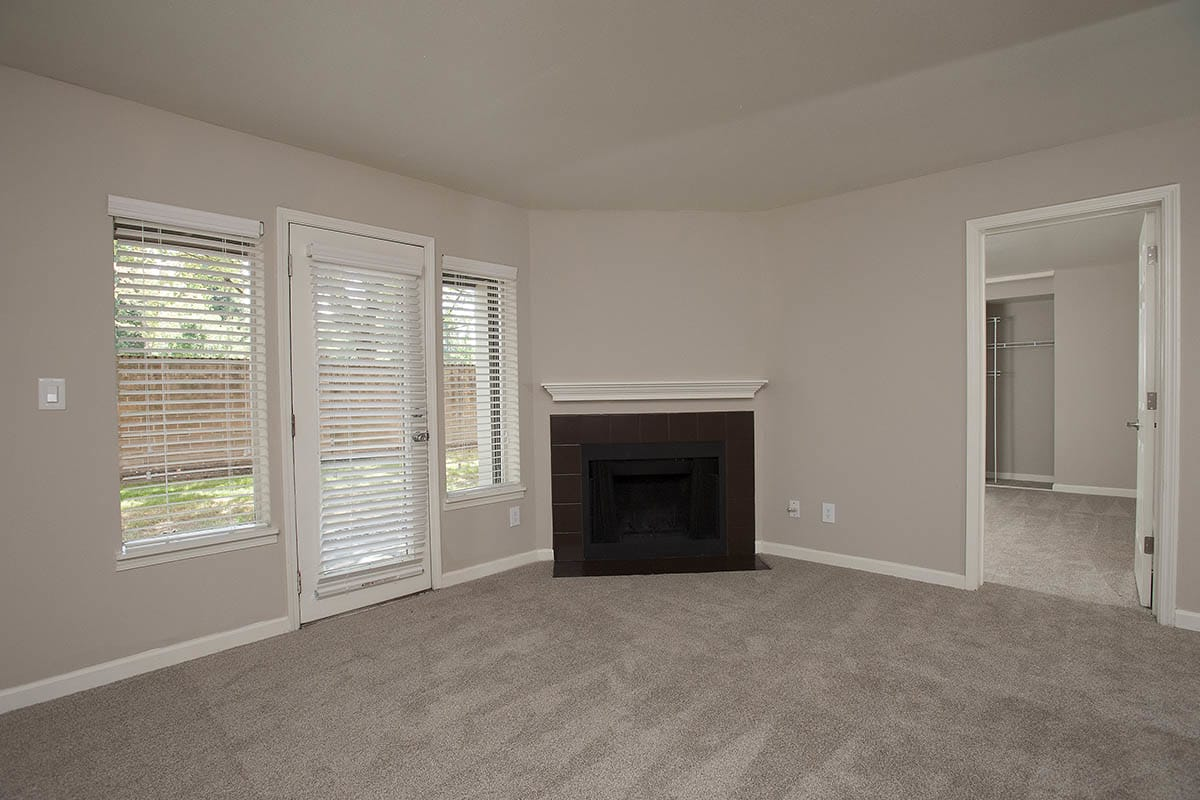 Living Room With Fireplace at Waterhouse Place in Beaverton