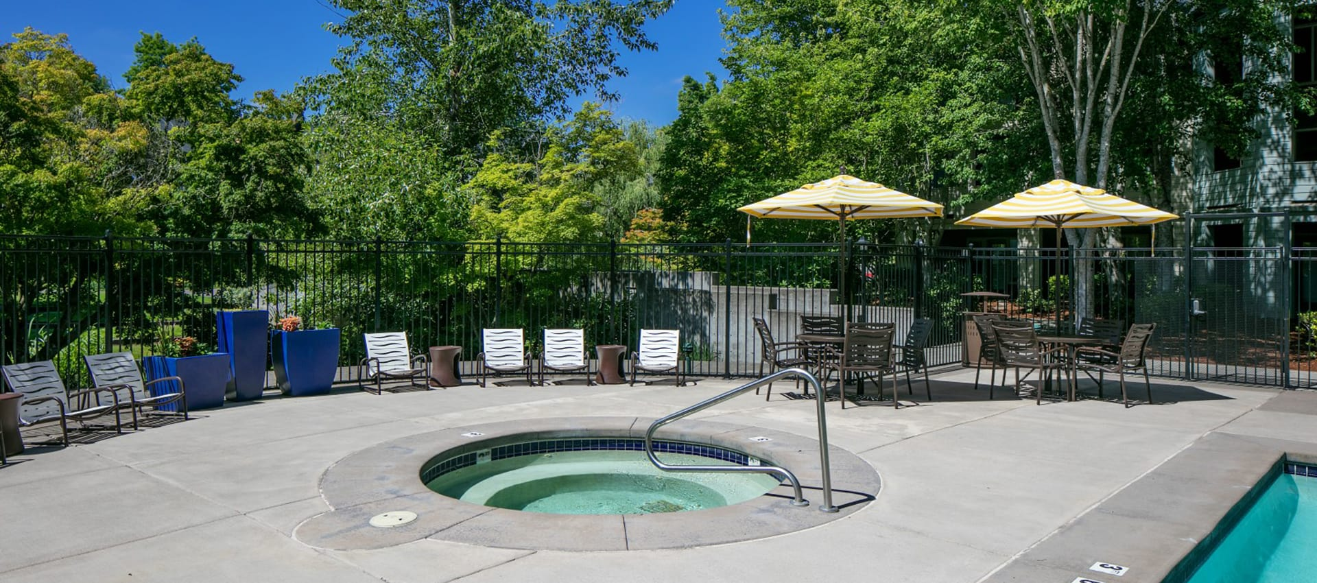 Table With Sun Umbrella By Hot Tub at Waterhouse Place in Beaverton, OR