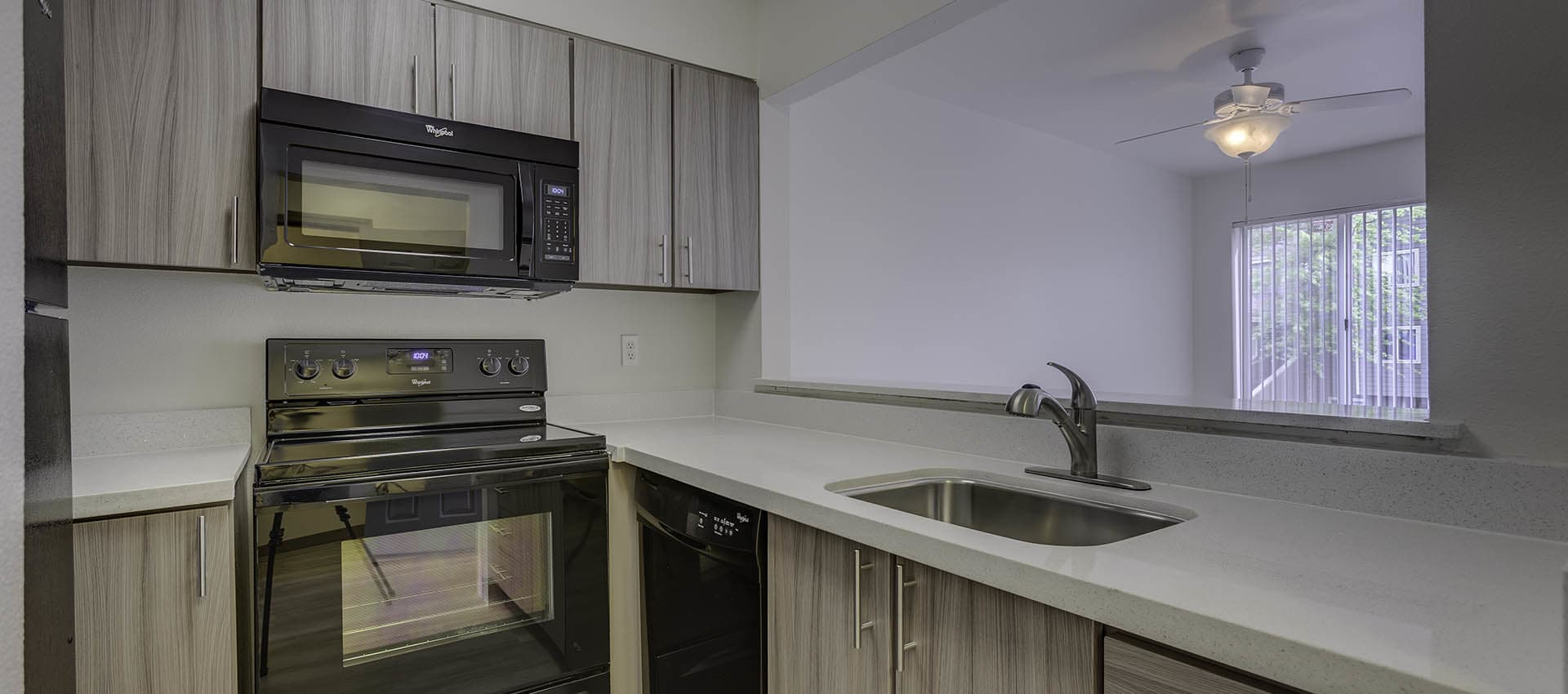 Upgraded Kitchen With Black Appliances at Waterhouse Place in Beaverton, OR