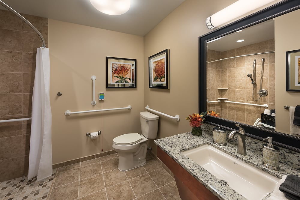 A spacious bathroom at Cedarbrook of Bloomfield Hills