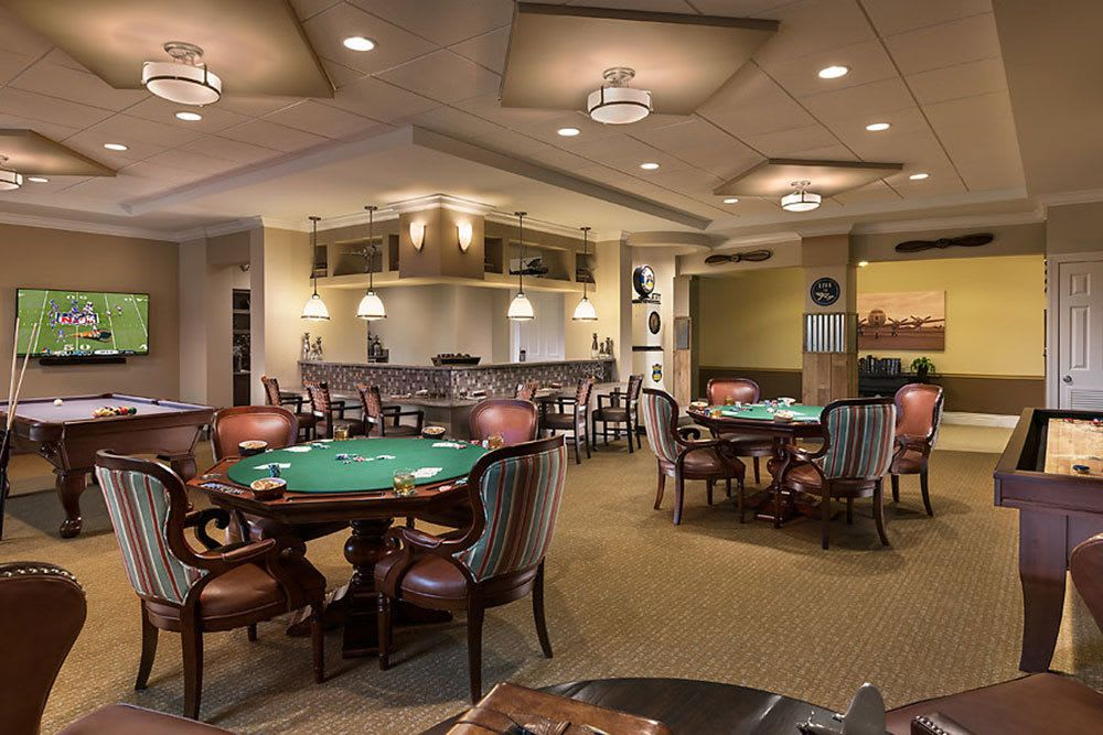 A view of the dining and card tables at Aviators Pub at Cedarbrook of Bloomfield Hills