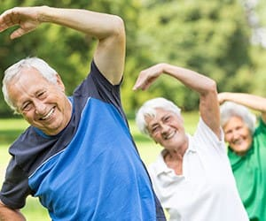 Senior living residents exercising in Plymouth