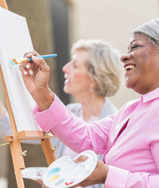 Senior living residents in Cedarbrook of Rochester painting