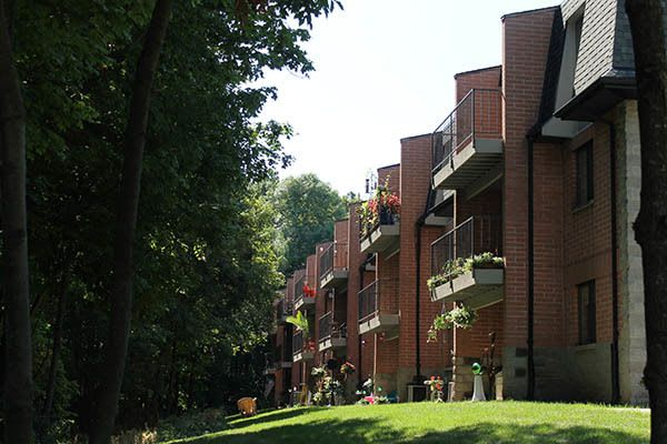 A sunny outdoor day at a Blake Capital Corp apartment complex.
