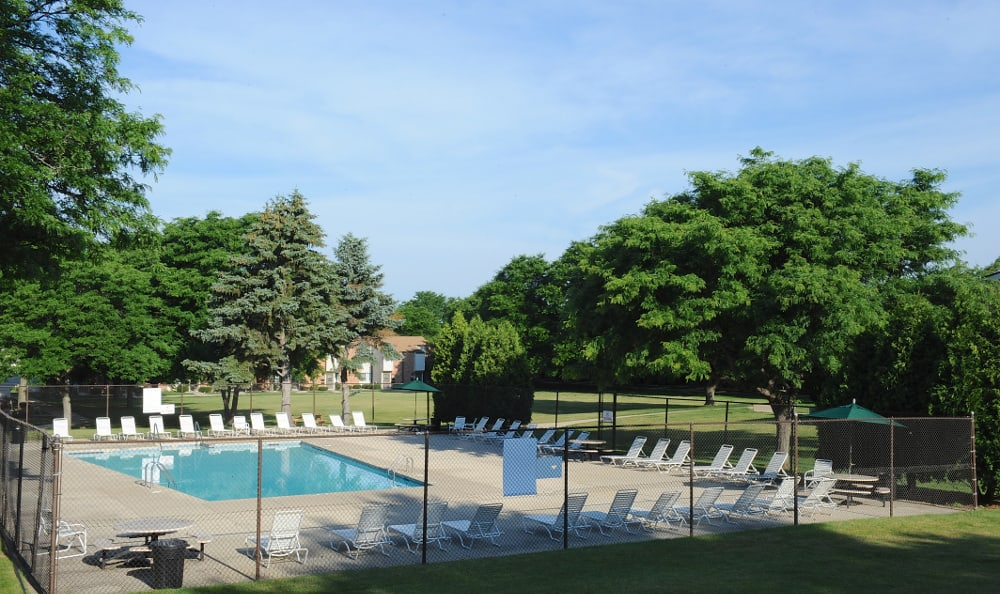 Relax by the pool at Briarwick Apartments in Greenfield, WI