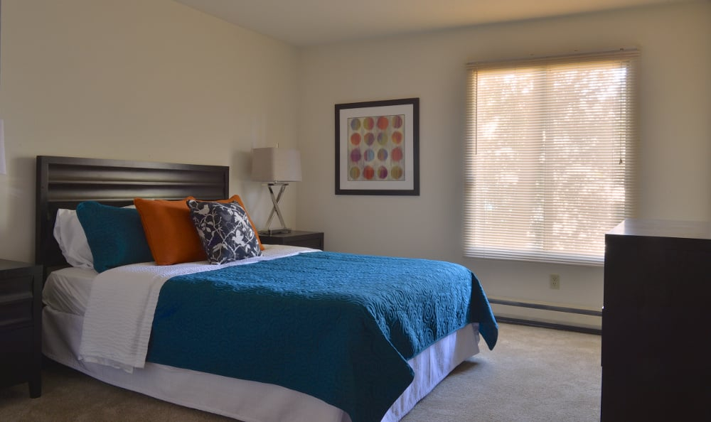 An example bedroom at Parquelynn Village Apartments in Nashotah, WI