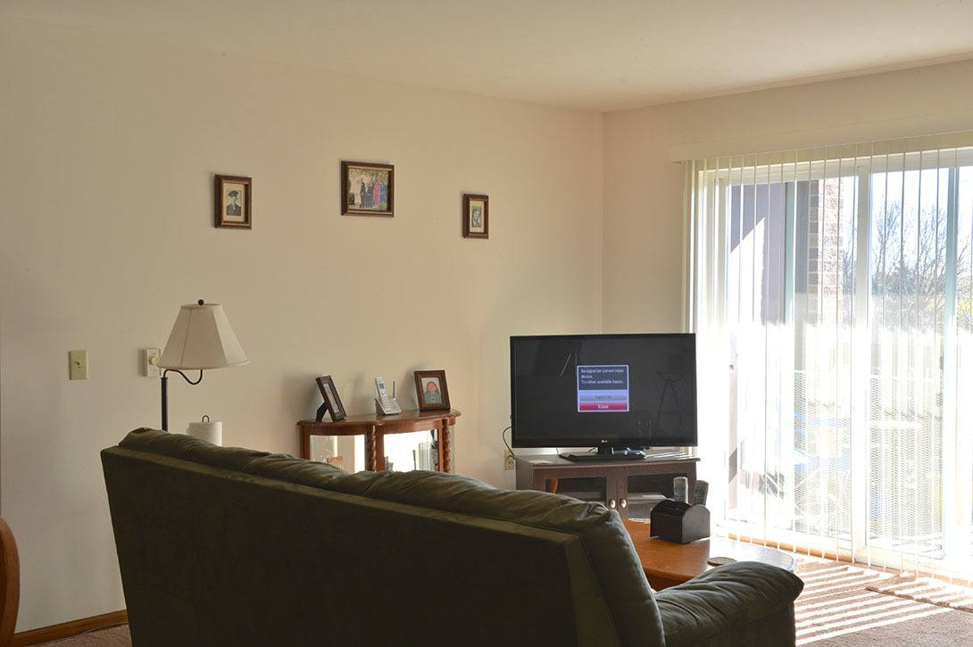 Model family room at Heather Downs Apartments
