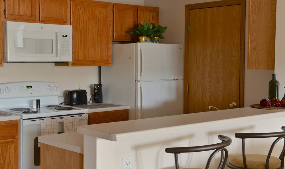 Kitchen Area In Unit At Hidden Oak Apartments