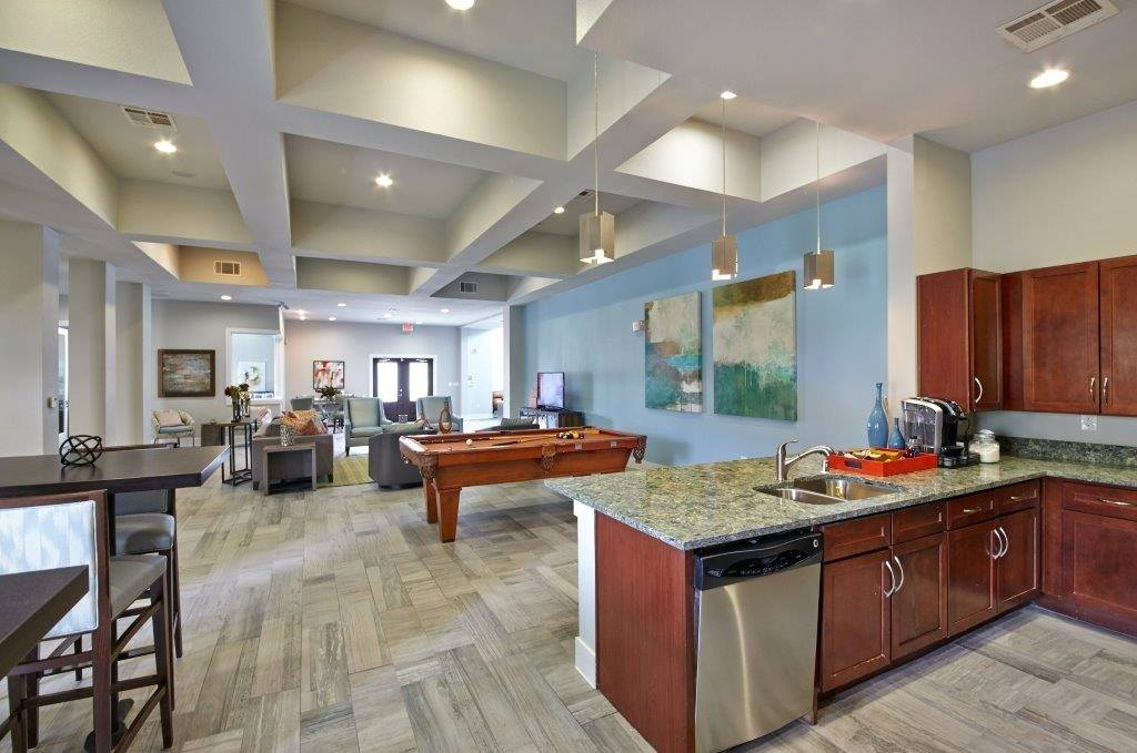 You'll enjoy the club house at Arioso Apartments & Townhomes in Grand Prairie, TX.