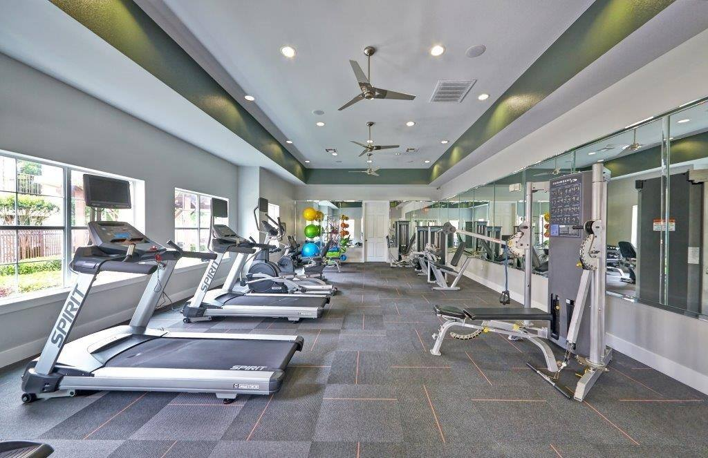 You'll enjoy using the fitness club at Arioso Apartments & Townhomes in Grand Prairie, TX.