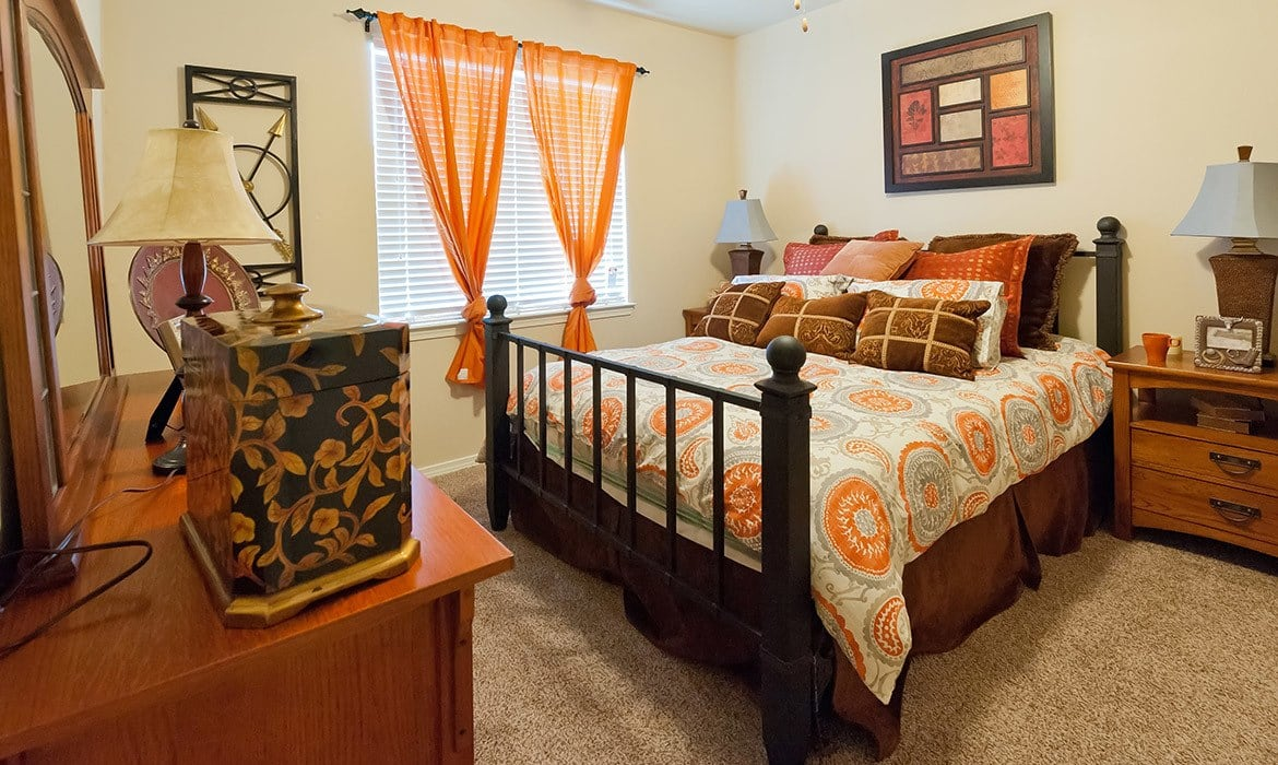 You'll love waking up in your large bedroom at Arioso Apartments in Grand Prairie, TX.