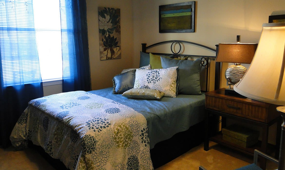 There's plenty of room for your bedroom set in your bedroom at Arioso Apartments in Grand Prairie, TX.