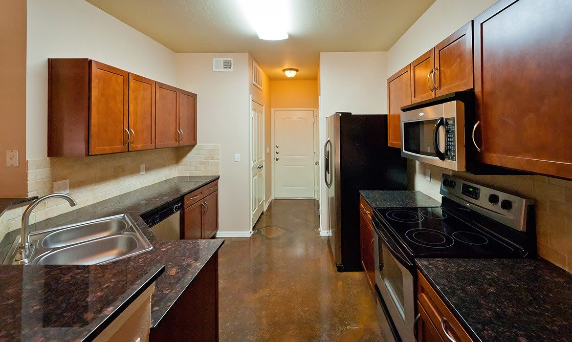 Spacious kitchens filled with modern conveniences await at Arioso Apartments in Grand Prairie, TX.