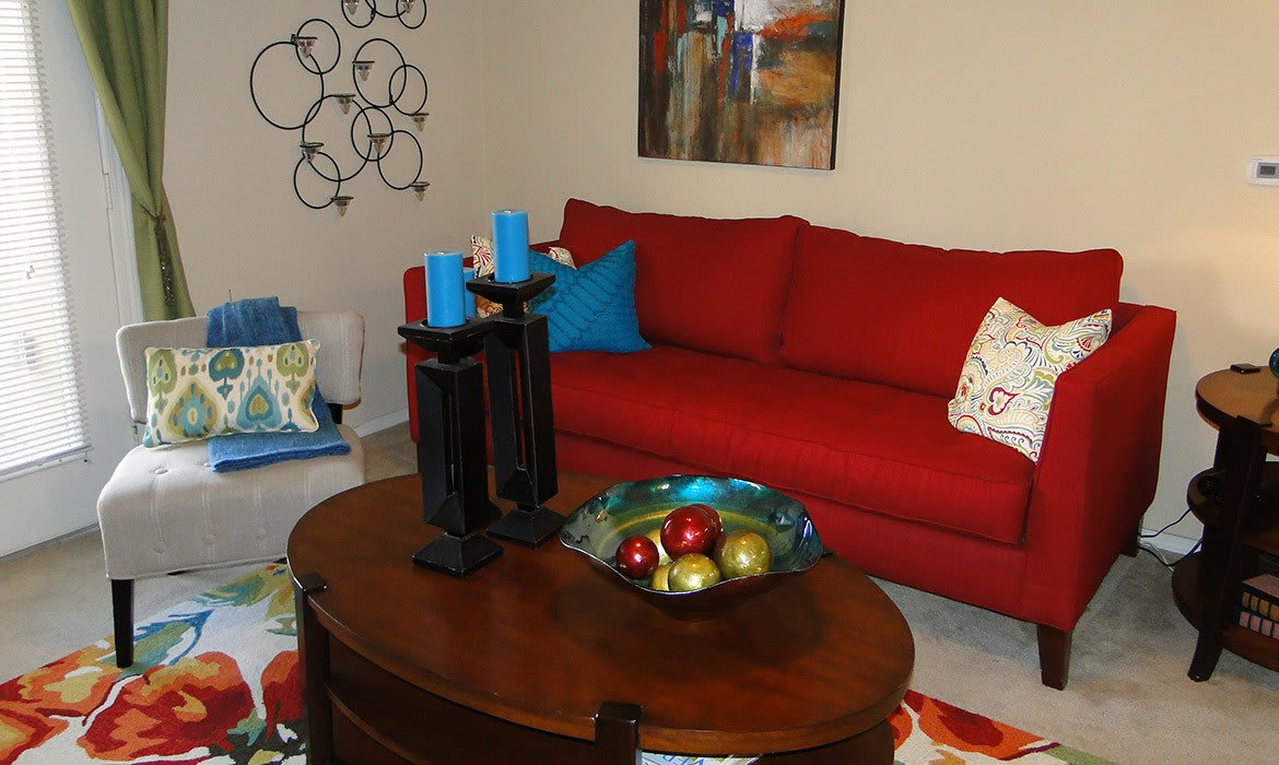 Your new living room at Arioso Apartments in Grand Prairie, TX is spacious and inviting.