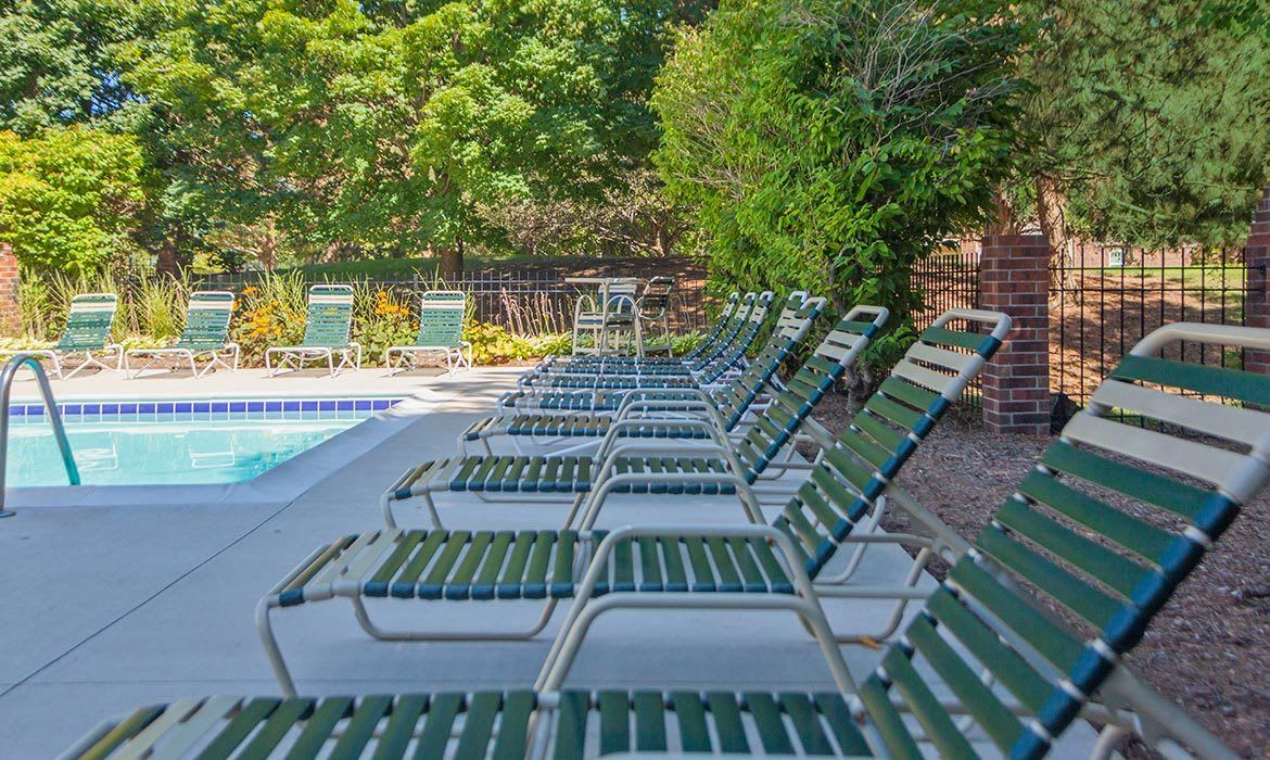 There's plenty of room to relax by the pool at Fairlane Meadow Apartments in Dearborn, MI.