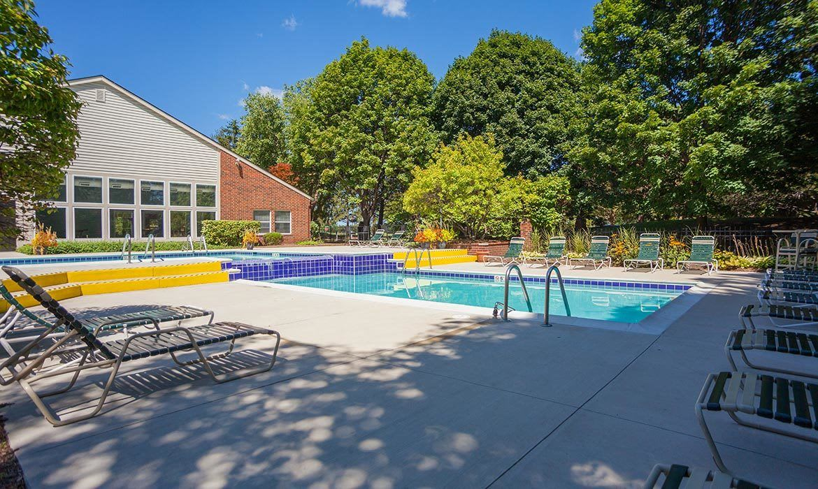 When you're done playing racquetball or tennis, take a dip in our gorgeous swimming pool at Fairlane Meadow Apartments in Dearborn, MI.